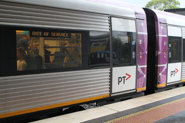 Passengers on a down Ararat service wait for the doors to be opened at Sunshine