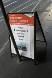 'V/Line Traralgon coaches depart here' notice at Flinders Street Station