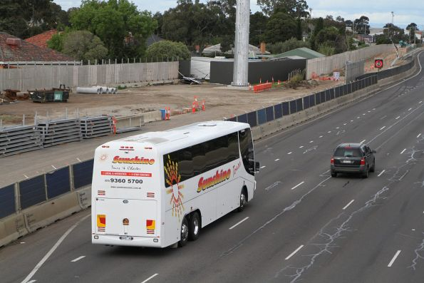 Sunshine Tours coach 8448AO on a citybound V/Line rail replacement service along the West Gate Freeway