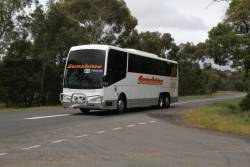 Sunshine Tours coach 7556AO on a Ballarat line rail replacement service on Old Melbourne Road, Ballan