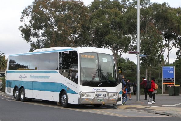 Bayside Coaches #41 BS01PL arrives at Sunshine station on a Ballarat line rail replacement service