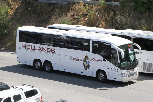 Hollands Adventure Holidays coach 6592AO arrives at Southern Cross