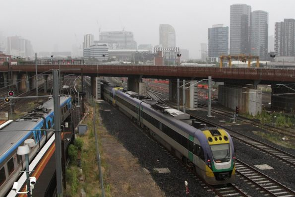Up Geelong train bypasses North Melbourne station on the RRL tracks, bound for Southern Cross with VL03 trailing