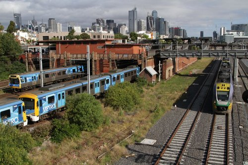 VLocity VL04 leads a down Geelong train past North Melbourne station on the RRL tracks