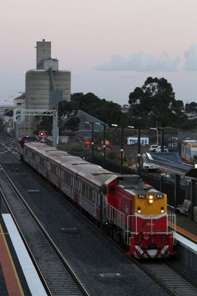 P11 leads a Bacchus Marsh bound push-pull train into the new platform 4 at Sunshine