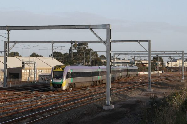 Citybound VLocity from Ballarat crosses onto the suburban tracks at Sunshine