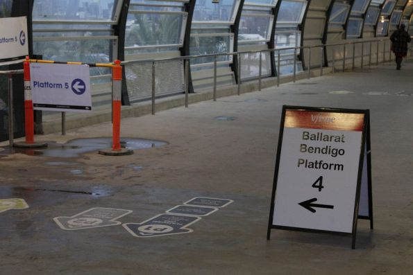 Sign directing Ballarat and Bendigo passengers to platform 4 on the newly opened RRL tracks at Footscray