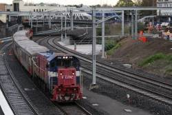 P14 leads a Bacchus Marsh push-pull service along the newly opened RRL tracks at Footscray