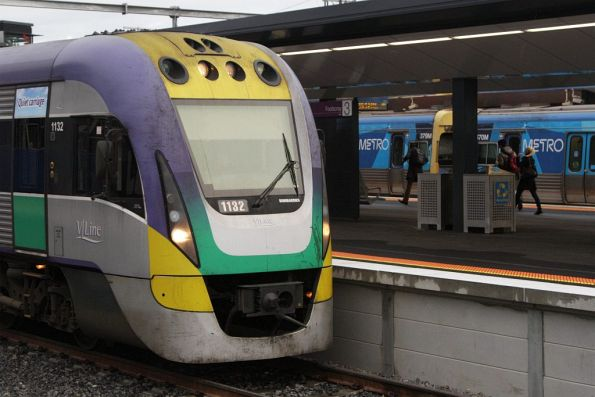 V/Line train in the dedicated RRL platforms at Footscray station, with suburban trains on the other side