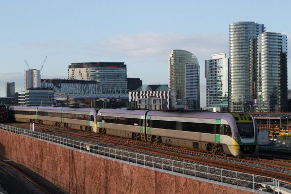 VLocity VL17 and classmate depart Southern Cross on the new RRL tracks over the North Melbourne flyover