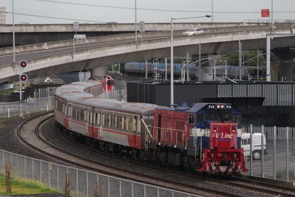 P14 leads a push-pull H set towards the North Melbourne flyover on the new RRL tracks