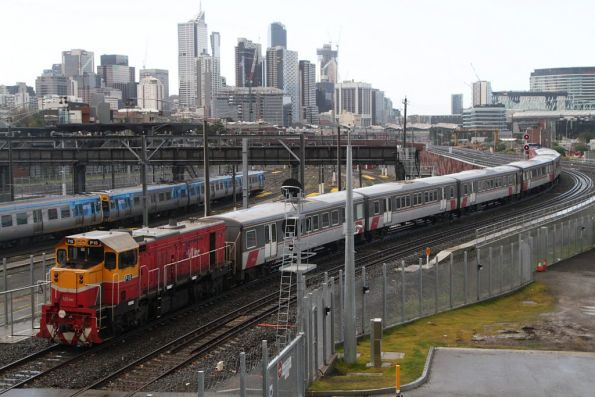 P15 trails a push-pull H set bound for Southern Cross, climbing to the North Melbourne flyover on the new RRL tracks