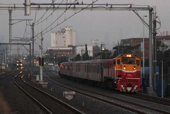 P12 leads a down Bacchus Marsh push-pull service along the RRL tracks at Tottenham