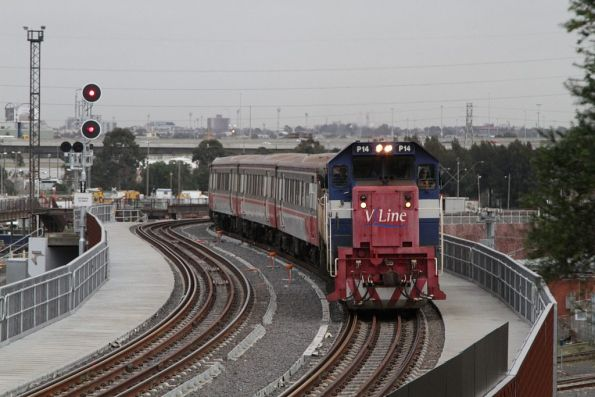 P14 leads a push-pull service over the North Melbourne flyover bound for Southern Cross