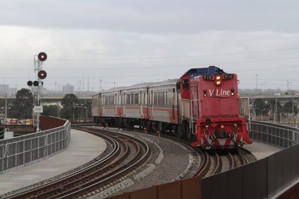 P18 heads over the North Melbourne flyover towards Southern Cross, and encounters a red signal