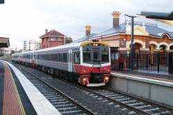 Sprinter 7018 and two classmates stop for passengers at Footscray platform 4