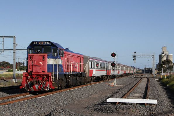 P18 leads a Bacchus Marsh bound push-pull service along the RRL tracks into Sunshine
