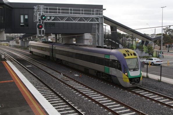 VLocity VL16 heads out of town along the RRL tracks at West Footscray