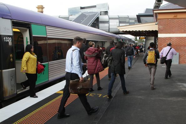 Passengers depart a V/Line service at Footscray, so they can change to a City Loop service