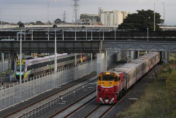 P15 leads a push-pull service towards Southern Cross at North Melbourne