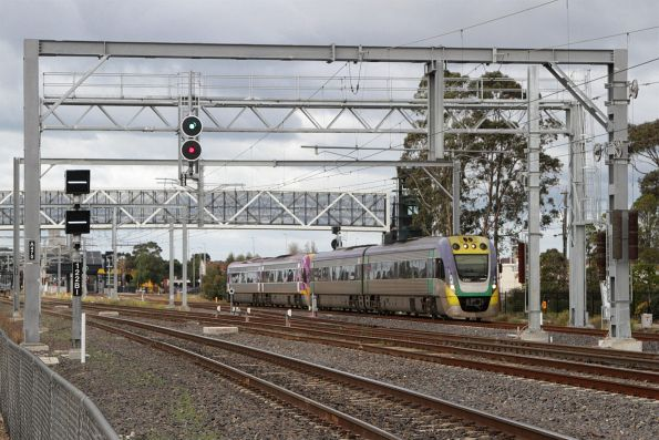 VL03 and VL12 on a down Bendigo service merge onto the suburban tracks at Sunshine