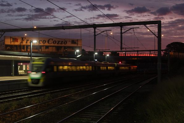 As the sun rises, a citybound VLocity departs Footscray