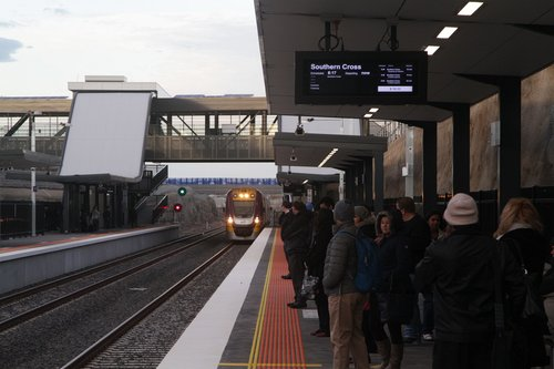 Platform full of passengers at Wyndham Vale wait for a citybound Geelong service to stop