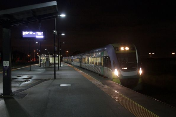 VLocity VL06 and classmate pause at Deer Park with a down Wyndham Vale service