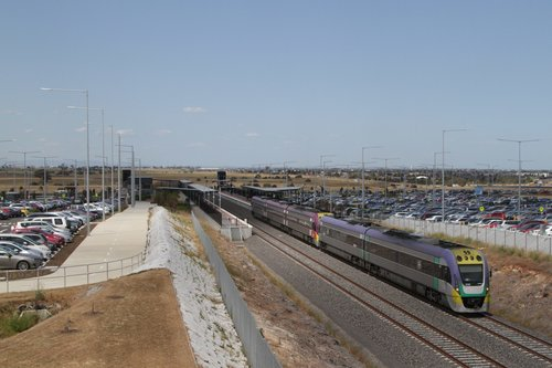 VLocity VL16 and classmate depart Tarneit on a down Geelong service