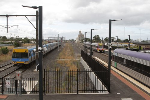 Trio of trains at Sunshine: pair of V/Line services outnumber the single Alstom Comeng