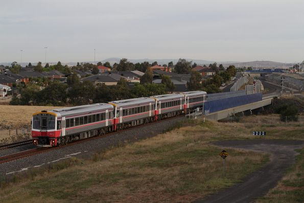 Sprinter 7016 and three classmates crawl out of Wyndham Vale minus passengers, bound for the Wyndham Vale South turnback siding