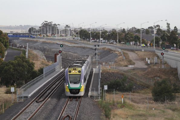 VLocity 3VL36 and classmate cross Lollypop Creek at Wyndham Vale with a down Geelong service