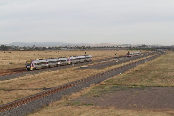 VLocity 3VL08 and classmate lead an up service past a waiting Sprinter consist at Wyndham Vale South