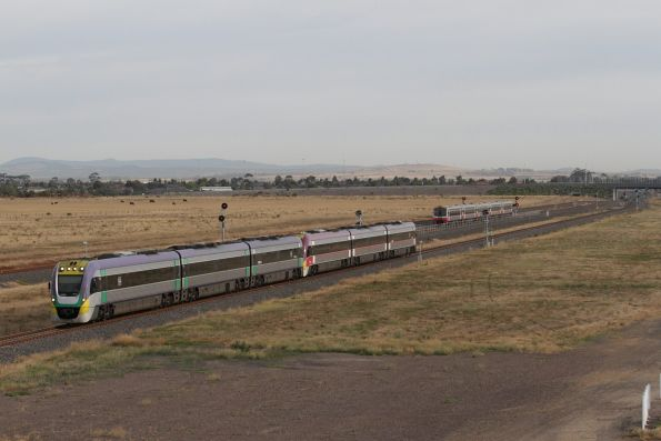 VLocity 3VL26 and 3VL47 on a down service pass a waiting Sprinter consist at Wyndham Vale South