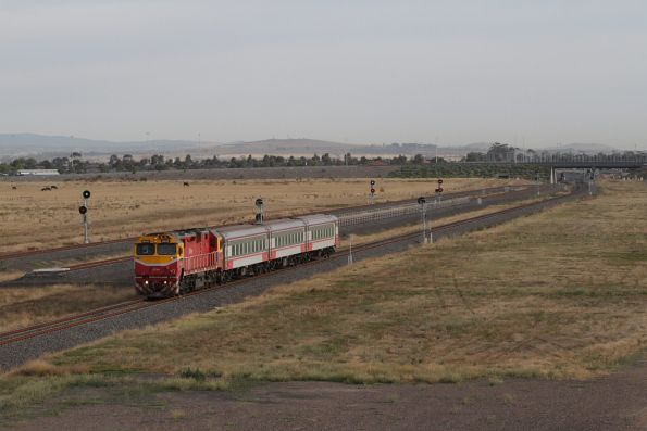 N455 leads the down Warrnambool service past the turnback siding at Wyndham Vale South
