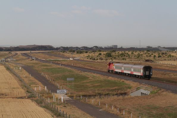 N455 leads the down Warrnambool service towards Manor Junction at Wyndham Vale South
