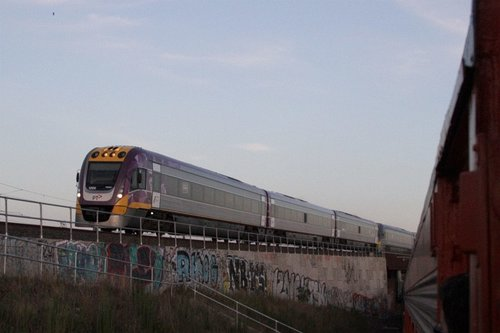 VLocity 3VL06 and classmate cross over the Maribyrnong River flyover