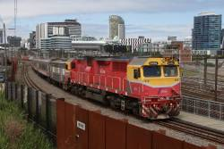 N456 leads a down train over the North Melbourne flyover