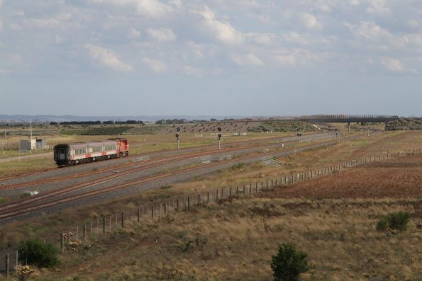 N460 leads a down Geelong train past the turnback siding at Wyndham Vale South