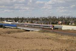 Pair of VLocity units on a down Geelong service pass over Lollypop Creek, Wyndham Vale