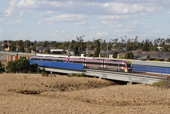 Pair of VLocity units on a down Geelong service cross Lollypop Creek at Wyndham Vale