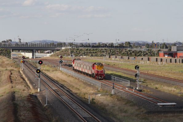 Signal already clear for departure, as an empty push-pull consist arrives at the Wyndham Vale South turnback siding