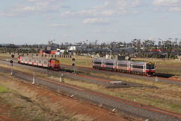 Quad Sprinters on a down Geelong service pass an empty push-pull consist at the Wyndham Vale South turnback siding