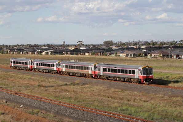Quad Sprinters led by 7012 on a down Geelong service at Wyndham Vale South