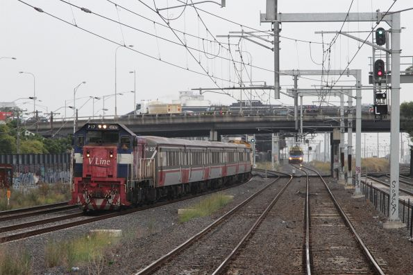 P17 leads a push-pull consist out of West Footscray, with a suburban train lucking in the distance