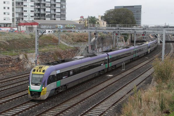 VLocity 3VL21 and classmate lead an up service out of Footscray