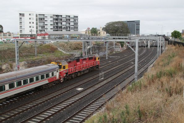 N467 leads a down service towards Footscray