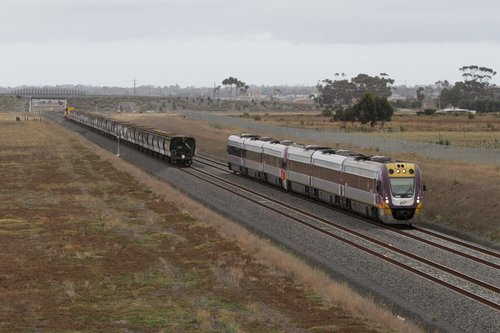 VLocity VL00 and classmate heads for Melbourne outside Tarneit