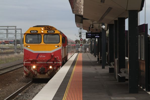N474 leads a down Geelong service into Sunshine