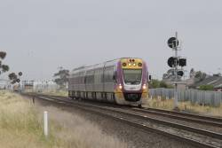 VLocity VL55 leads a down service towards Deer Park Junction